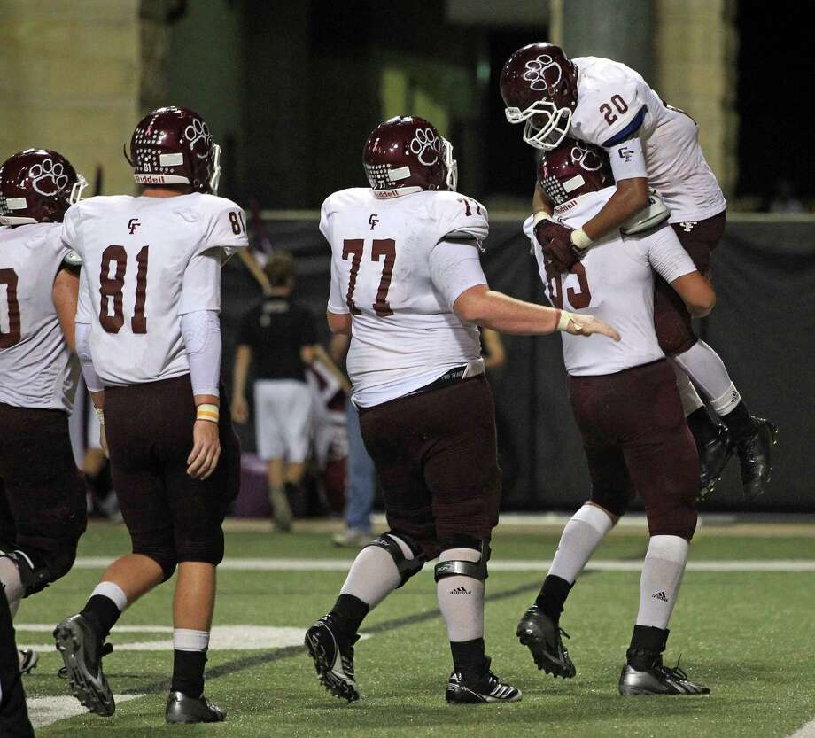 Cy-Fair's Dillon Birden (20) is lifted by teammate Luis Lopez after Birden scored a touchdown during the second half of a high school football game against Cy-Woods, Saturday, October 12, 2013 at Berry Center in Cypress. Photo: Eric Christian Smith, For The Chronicle