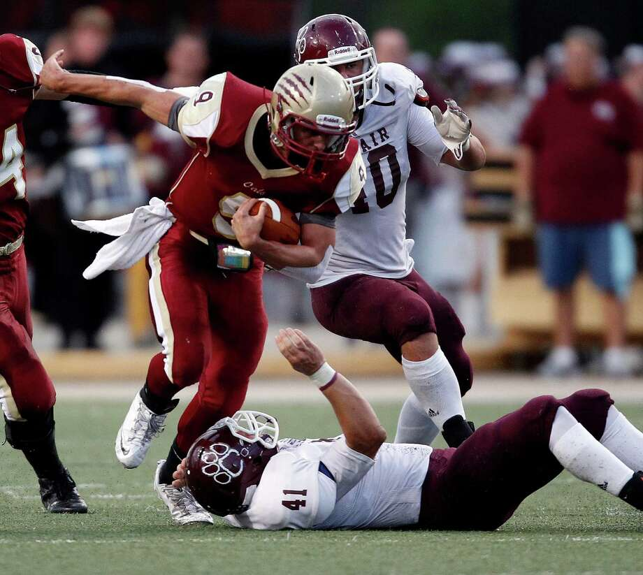 Cy-Woods' Nick Hooper (9) escapes the tackle of Cy-Fair's James Kohlschmidt during the first half of a high school football game, Saturday, October 12, 2013 at Berry Center in Cypress. Photo: Eric Christian Smith, For The Chronicle