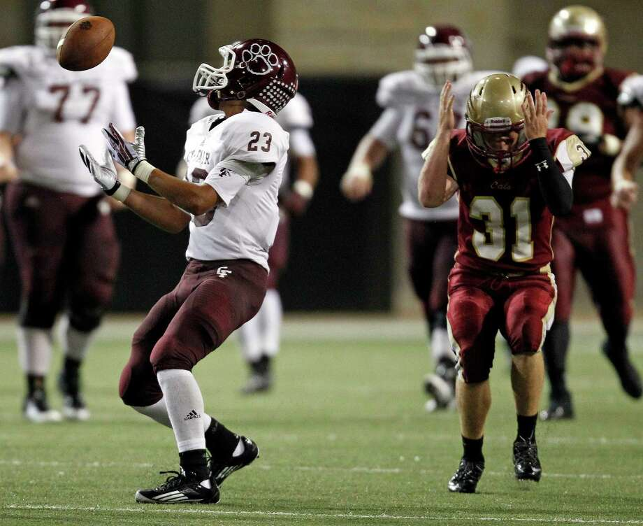 Cy-Woods' Wade Carson (31) reacts after missing an interception opportunity on a deflected ball by Cy-Fair's Preston Wallace during the second half of a high school football game, Saturday, October 12, 2013 at Berry Center in Cypress. Photo: Eric Christian Smith, For The Chronicle