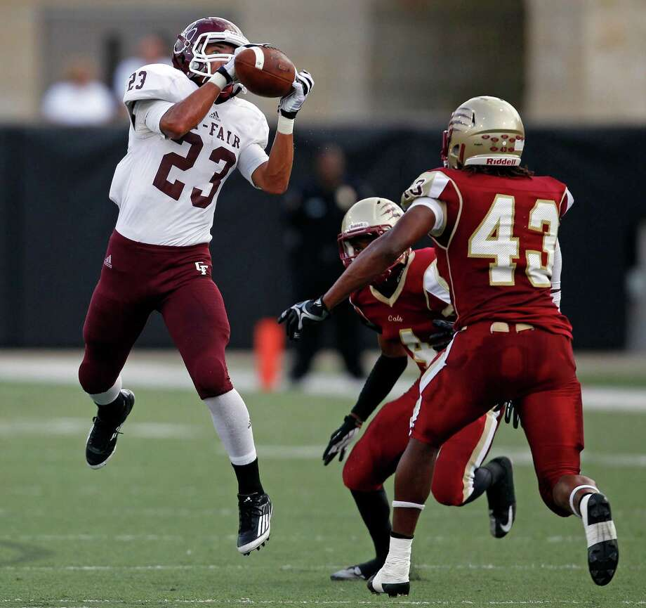 Cy-Fair's Preston Wallace (23) makes a reception past Cy-Woods' Taylor Holmes (43) during the first half of a high school football game, Saturday, October 12, 2013 at Berry Center in Cypress. Photo: Eric Christian Smith, For The Chronicle