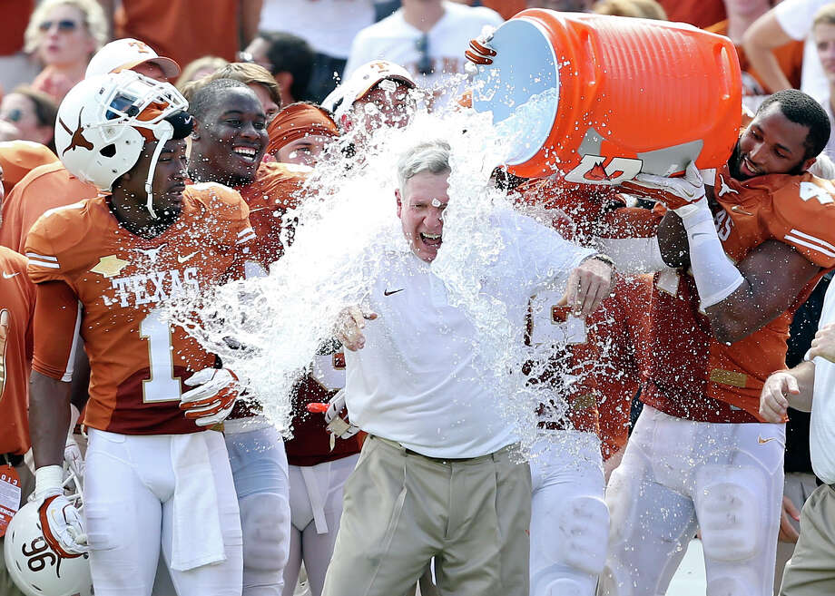 Saturday's win, punctuated by Jackson Jeffcoat's dousing of Mack Brown, will have a chilling effect on the critics of Brown's program. Photo: Edward A. Ornelas, Staff / © 2013 San Antonio Express-News