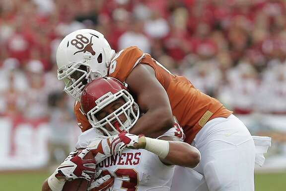 A stout defensive effort by Texas included a stop of Oklahoma fullback Trey Millard by Longhorns defensive end Cedric Reed.