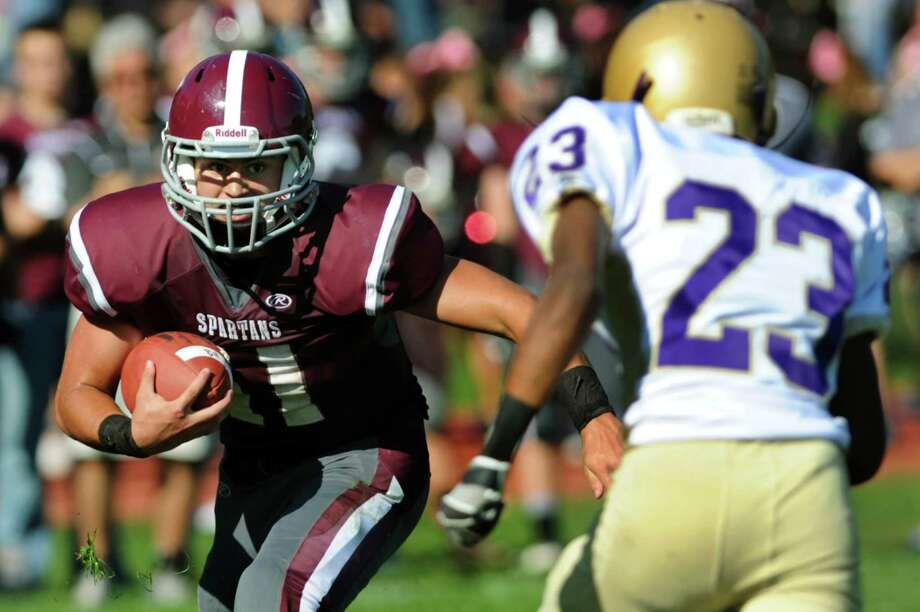 Burnt Hills Danny Maynard, left, carries the ball as Amsterdam's Dennis Bier defends during their football game on Saturday, Oct. 12, 2013, at Burnt Hills High in Burnt Hills, N.Y. (Cindy Schultz / Times Union) Photo: Cindy Schultz / 00024232A