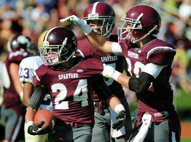 Burnt Hills' Josh Quesada, left, celebrates a touchdown with teammates Packy Brown, center, and Tyler Dowdle during their football game against Amsterdam on Saturday, Oct. 12, 2013, at Burnt Hills High in Burnt Hills, N.Y. (Cindy Schultz / Times Union) Photo: Cindy Schultz / 00024232A