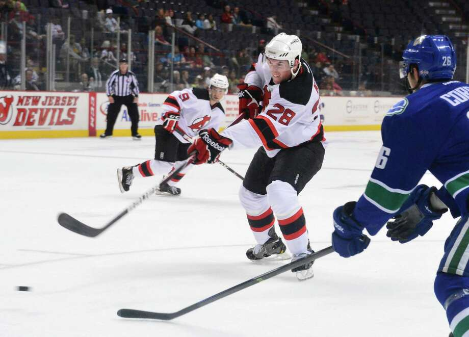Albany Devils' #28 Dan Kelly takes a shot on goal during the Devil's home opener against the Utica Comets at the Times Union Center Saturday Oct. 12, 2013, in Albany, NY.  (John Carl D'Annibale / Times Union) Photo: John Carl D'Annibale / 00024187A