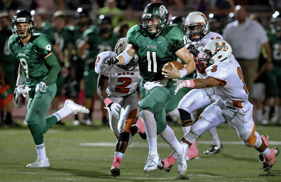 Ty Summers takes off on a touchdown run for the Rattlers as Madison plays Reagan at Heroes  Stadium on October 12, 2013. Photo: TOM REEL