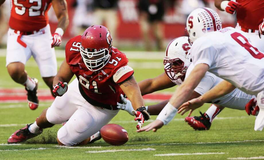 Utah's Tenny Palepoi, left, gathers in a fumble by Stanford quarterback Kevin Hogan (8). Photo: George Frey, Stringer / 2013 Getty Images
