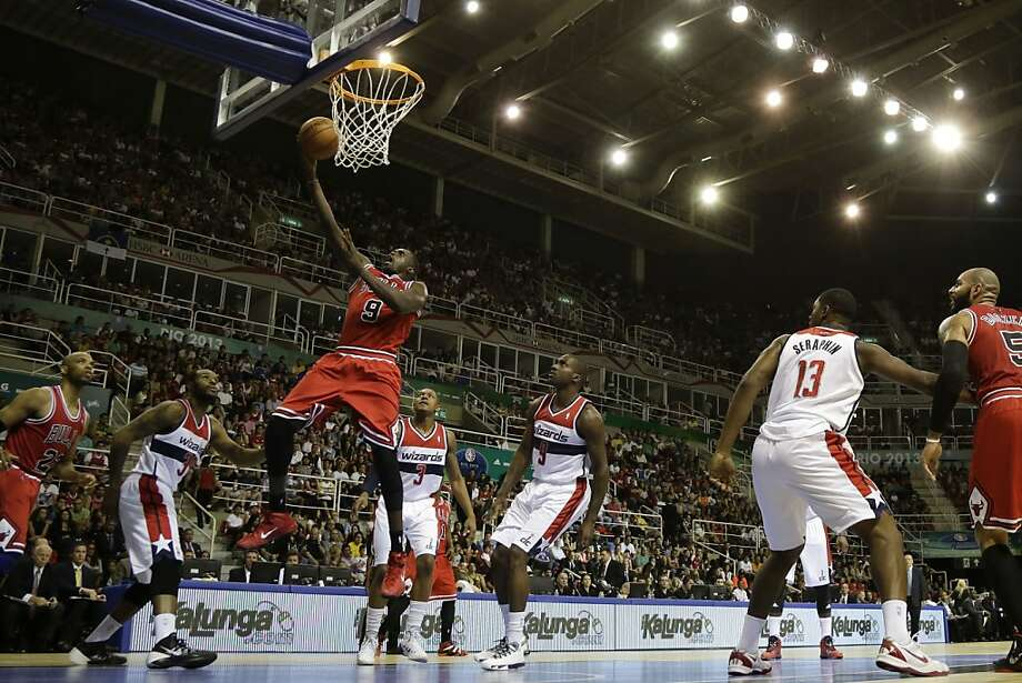 Chicago's Luol Deng scores past a few Washington Wizards during the first NBA preseason game in Rio de Janeiro. Photo: Felipe Dana, Associated Press