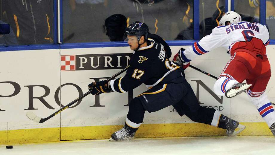 New York Rangers' Anton Stralman (6), of Sweden, reaches for St. Louis Blues' Vladimir Sobotka (17), of Czech Republic, during the second period of an NHL hockey game on Saturday, Oct. 12, 2013, in St. Louis. (AP Photo/Bill Boyce) ORG XMIT: MOBB108 Photo: Bill Boyce / FR84052 AP