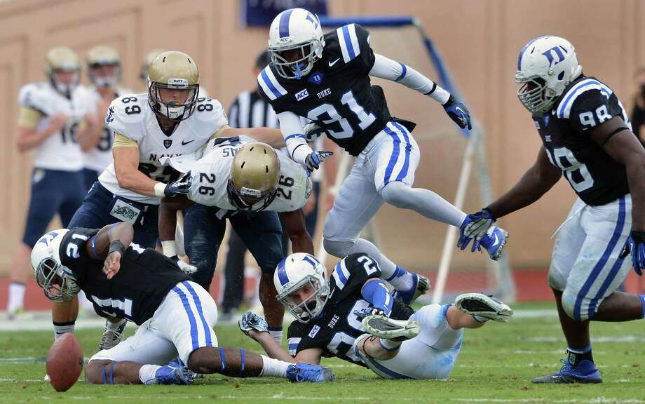The Duke defense causes one of Navy's season-high three turnovers late in Saturday's game. Navy also matched its season high with five penalties. Photo: Chuck Liddy / Raleigh News & Observer / MCT