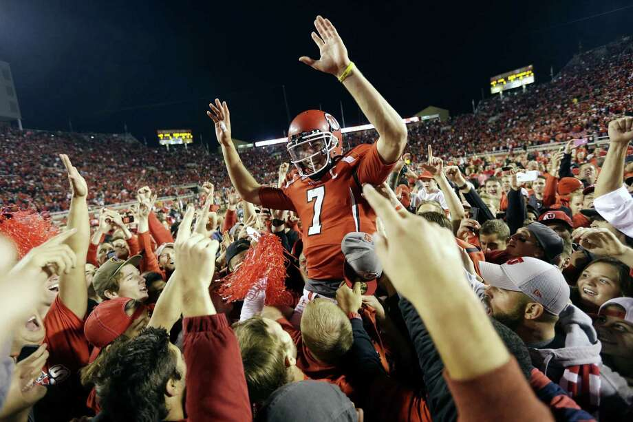 Utah QB Travis Wilson is hoisted by fans Saturday after the Utes upset No. 5 Stanford with the help of a last-minute defensive stand at their goal line. Photo: Rick Bowmer / Associated Press