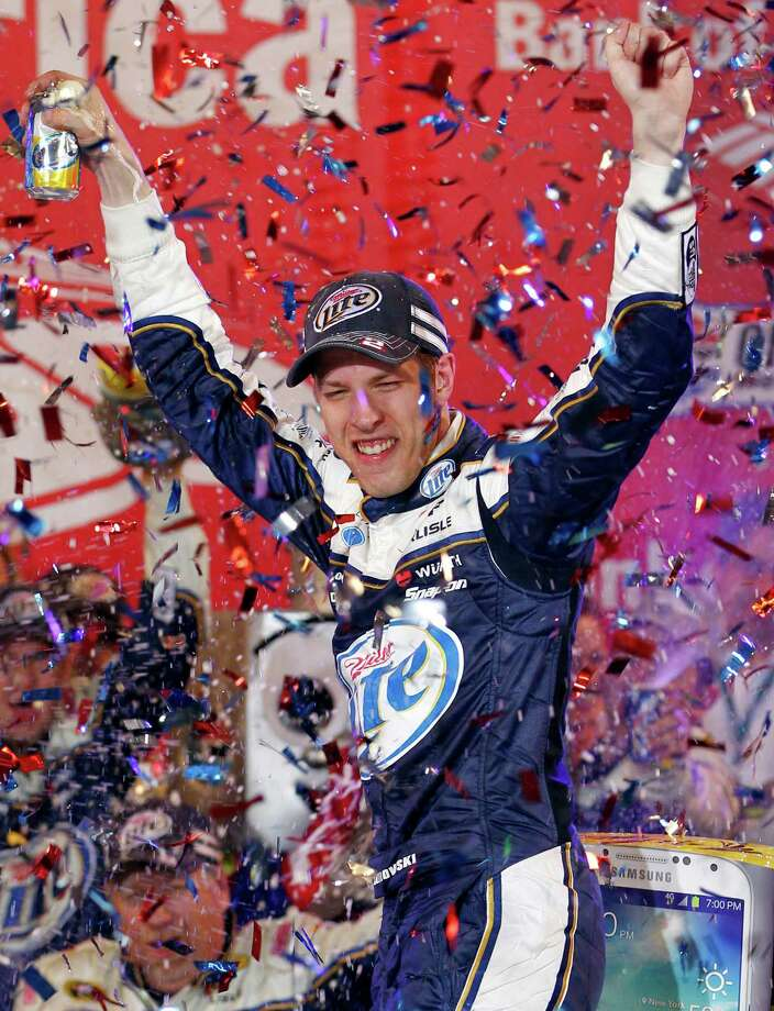 Brad Keselowski celebrates in Victory Lane after winning the NASCAR Sprint Cup Series auto race at Charlotte Motor Speedway in Concord, N.C., Saturday, Oct. 12, 2013. (AP Photo/Terry Renna) ORG XMIT: NCGB115 Photo: Terry Renna / FR60642 AP