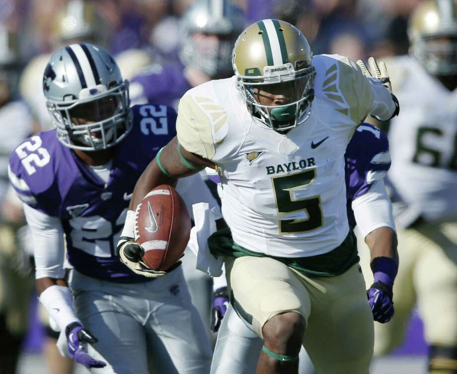 With Kansas State defensive back Dante Barnett in pursuit, Baylor wide receiver Antwan Goodley races to the end zone Saturday. The 72-yard score, on a pass from Bryce Petty, gave the Bears a 21-10 halftime lead. Photo: Orlin Wagner / Associated Press