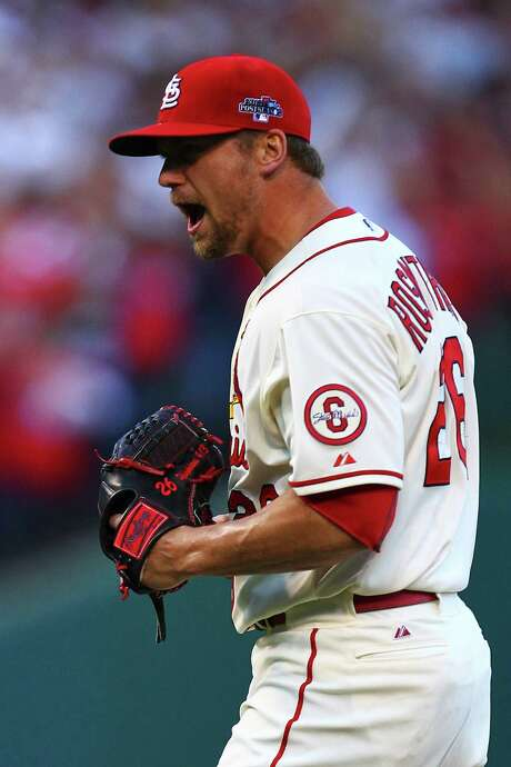 The Cardinals' Trevor Rosenthal, who struck out the side in the ninth, exults after fanning pinch-hitter Andre Ethier in Game 2. Photo: Dilip Vishwanat / Getty Images