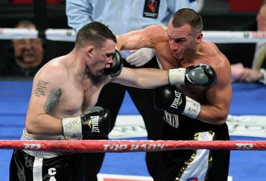 Sean Monaghan (right) lands a punch on Anthony Smith in the third round of their light heavyweight bout Saturday. Monaghan won by TKO in the round. Photo: Ethan Miller / Getty Images
