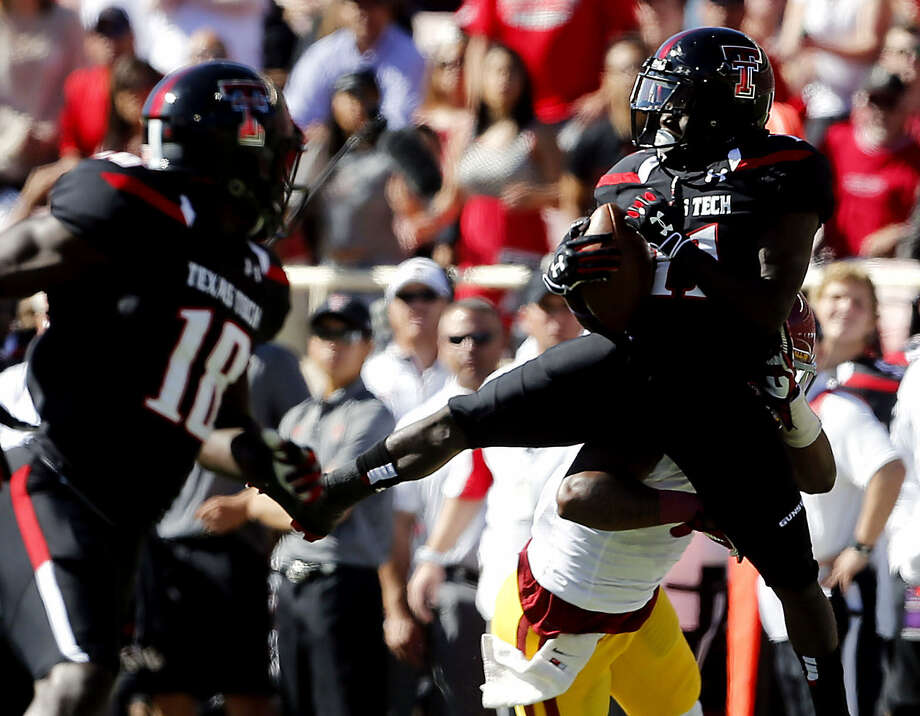 Texas Tech's Jakeem Grant (right) hauls in a TD, one of three scoring tosses from backup QB Davis Webb in the Red Raiders' 42-35 win over Iowa State. Photo: Orlin Wagner / Associated Press