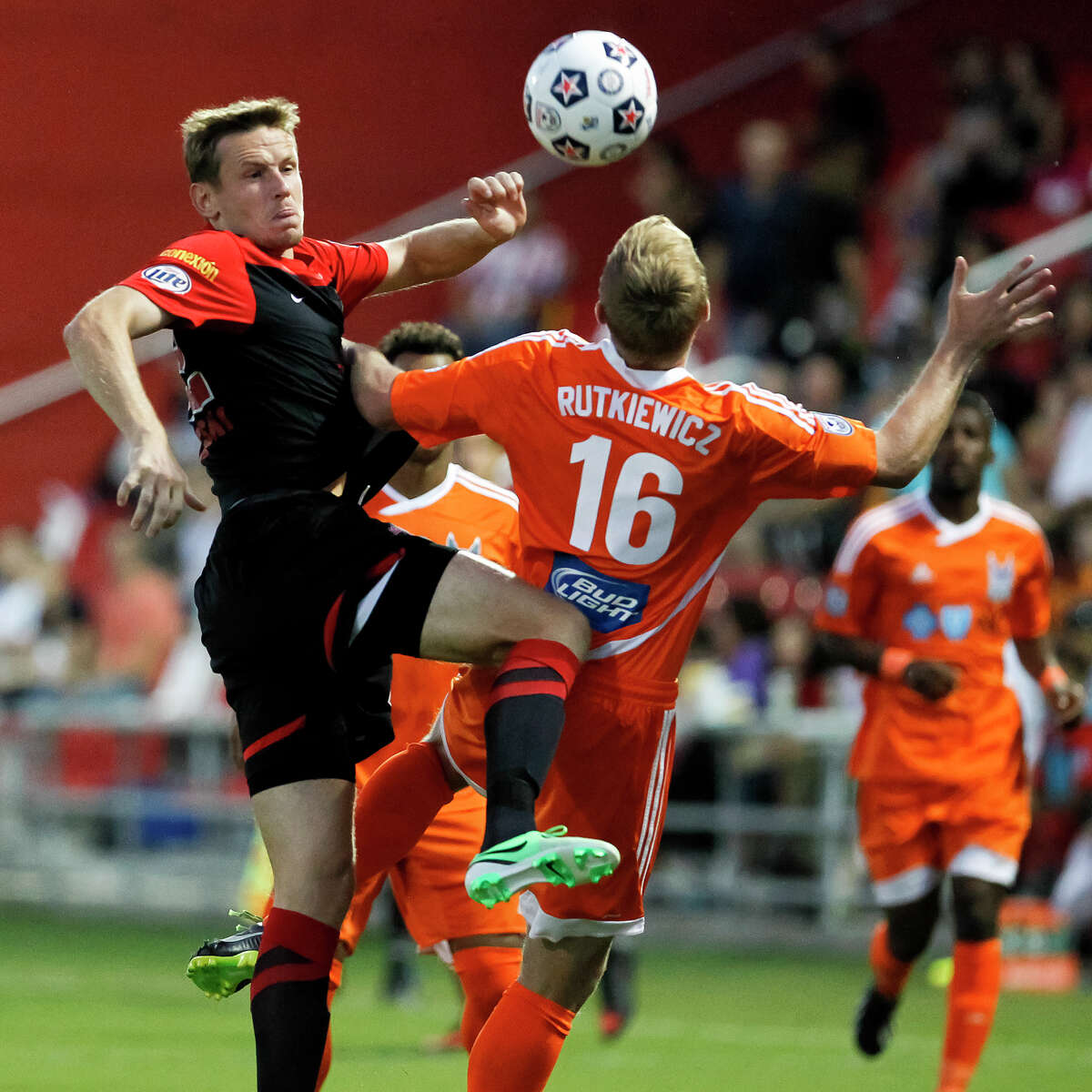 Tomasz Zahorski of the Scorpions battles for the ball with Kevin Rutkiewicz of the Carolina RailHawks in the first half of their game at Toyota Field on Saturday, Sept. 21, 2013. MARVIN PFEIFFER/ mpfeiffer@express-news.net