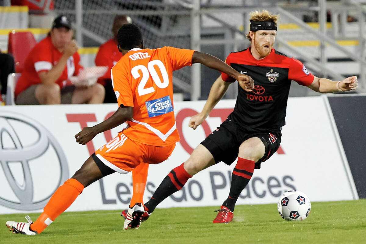 Patrick Phelan (right) of the Scorpions changes direction with the ball on Breiner Ortiz of the Carolina RailHawks during the first half of their game at Toyota Field on Saturday, Sept. 21, 2013. MARVIN PFEIFFER/ mpfeiffer@express-news.net