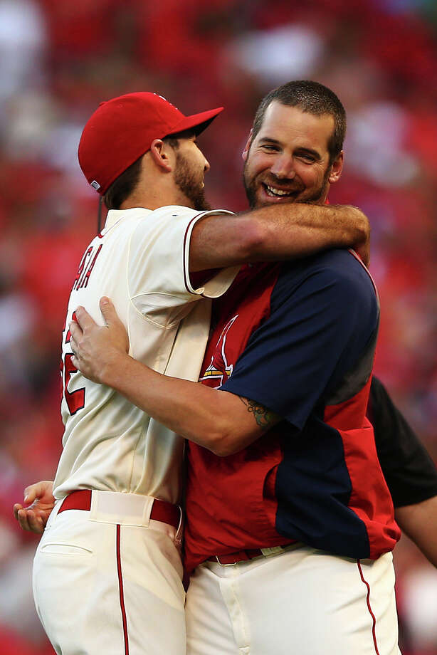 Michael Wacha, left, earns a pat on the back from Chris Carpenter, a Cardinal with plenty of his own playoff success. Photo: Elsa, Staff / 2013 Getty Images