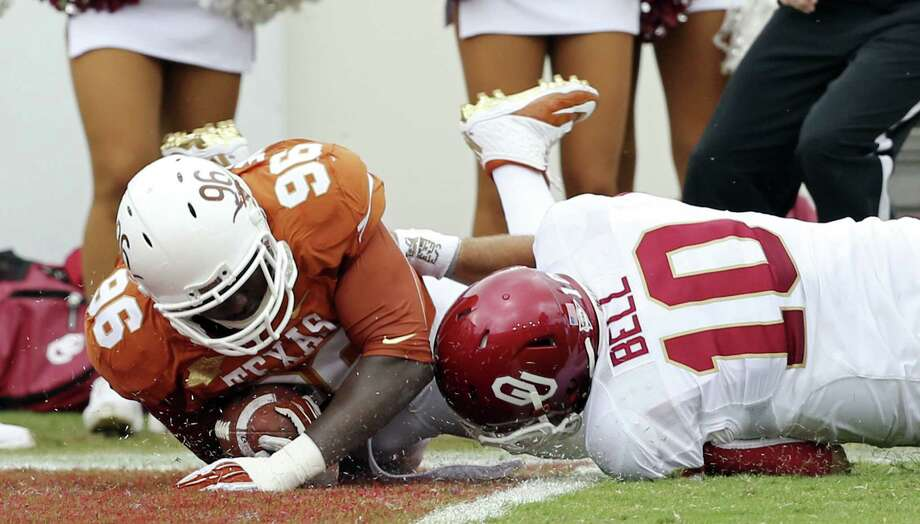 Texas defensive tackle Chris Whaley scores on a 31-yard interception return in the first quarter as Oklahoma QB Blake Bell can't bring him down in time. Photo: Photos By Edward A. Ornelas / San Antonio Express-News