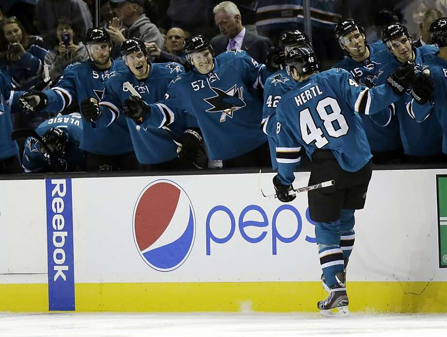 Sharks rookie Tomas Hertl celebrates his first-period goal, his seventh of the season. He later left the game after colliding headfirst with a Senators player. Photo: Marcio Jose Sanchez, Associated Press