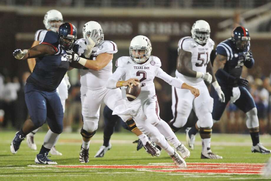Texas A&M 41, Ole Miss 38Record: 5-1  Texas A&M's Johnny Manziel (2) scrambles against Mississippi during an NCAA college football game, Saturday, Oct. 12, 2013 at Vaught-Hemingway Stadium in Oxford, Miss. (AP Photo/Oxford Eagle, Bruce Newman) MAGS OUT; NO SALES; MANDATORY CREDIT Photo: Bruce Newman, Associated Press