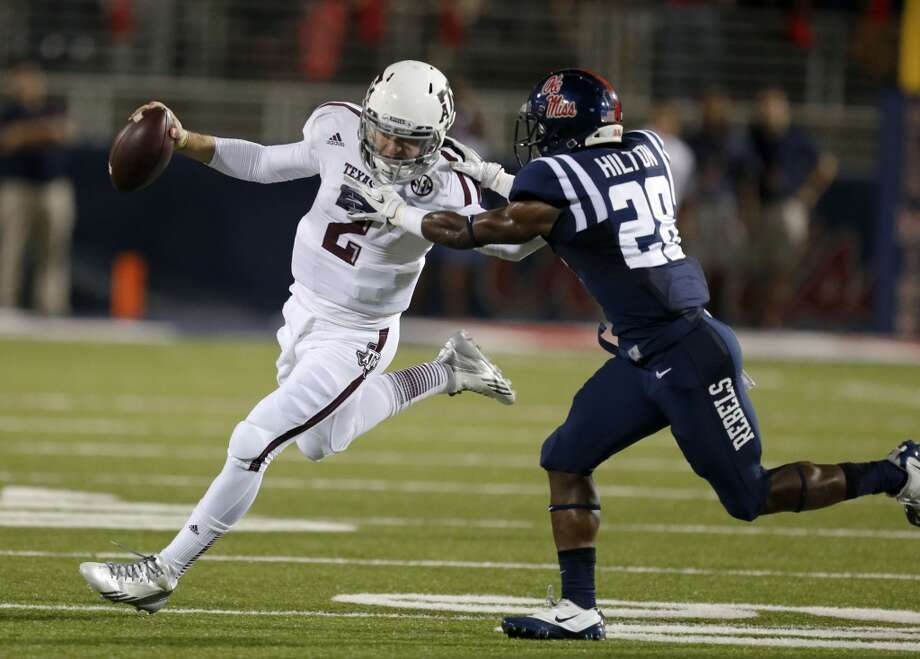 Texas A&M quarterback Johnny Manziel (2) is tackled by Mississippi defensive back Mike Hilton (28) in the first half of an NCAA college football game at Vaught-Hemingway Stadium in Oxford, Miss., Saturday, Oct. 12, 2013. (AP Photo/Rogelio V. Solis) Photo: Rogelio V. Solis, Associated Press