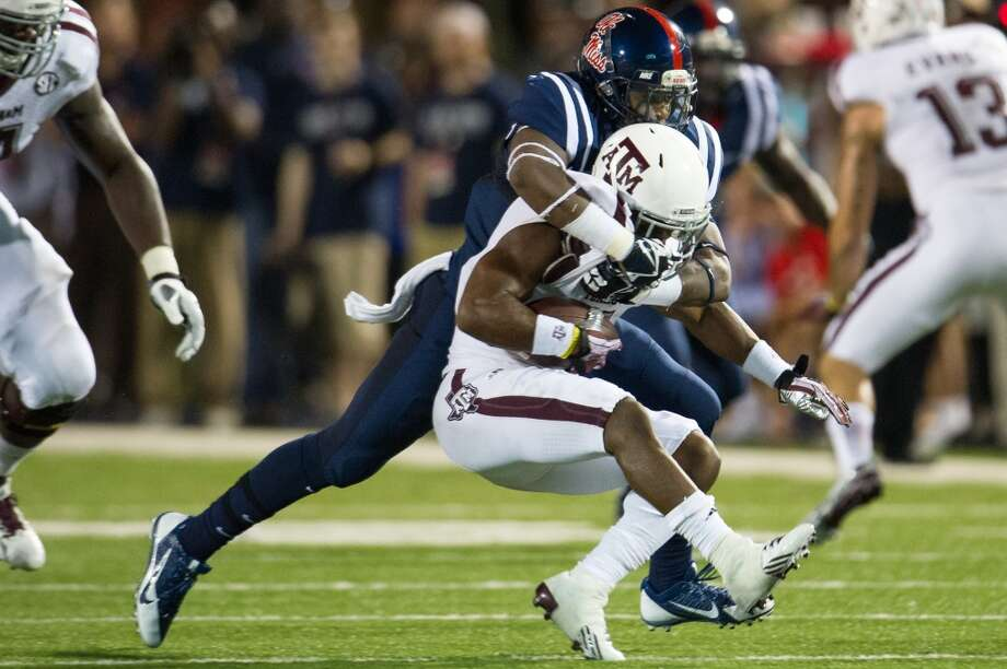 OXFORD, MS - OCTOBER 12:  Linebacker Keith Lewis #24 of the Ole Miss Rebels tackles running back Ben Malena #1 of the Texas A&M Aggies  on October 12, 2013 at Vaught-Hemingway Stadium in Oxford, Mississippi. At halftime Texas A&M leads Ole Miss 14-10.  (Photo by Michael Chang/Getty Images) Photo: Michael Chang, Getty Images