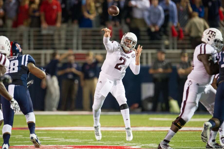 OXFORD, MS - OCTOBER 12:  Quarterback Johnny Manziel #2 of the Texas A&M Aggies throws a pass downfield during their game against the Ole Miss Rebels on October 12, 2013 at Vaught-Hemingway Stadium in Oxford, Mississippi. At halftime Texas A&M leads Ole Miss 14-10.  (Photo by Michael Chang/Getty Images) Photo: Michael Chang, Getty Images