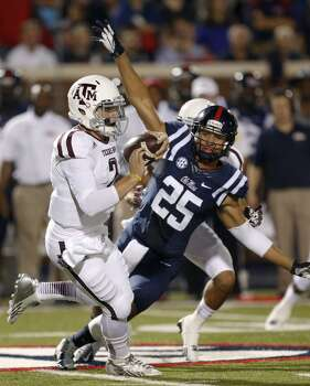 Texas A&M quarterback Johnny Manziel (2) runs past Mississippi defensive back Cody Prewitt (25) for a first down in the first half of an NCAA college football game at Vaught-Hemingway Stadium in Oxford, Miss., Saturday, Oct. 12, 2013. (AP Photo/Rogelio V. Solis) Photo: Rogelio V. Solis, Associated Press