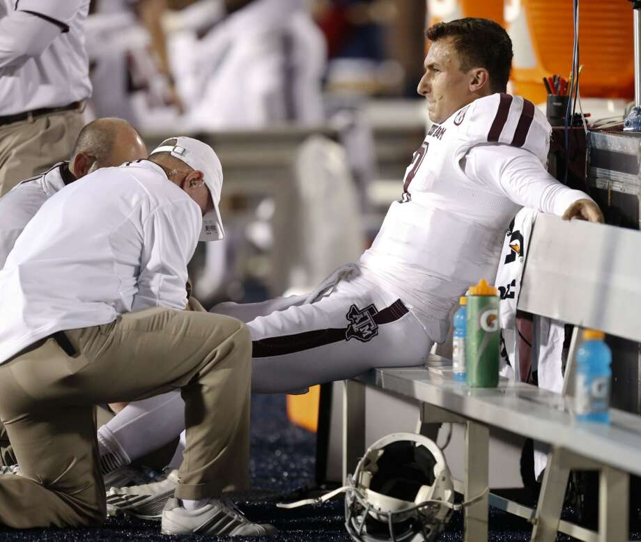 Texas A&M quarterback Johnny Manziel (2) grimaces as his injury is tended to in the first half of their NCAA college football game against Mississippi at Vaught-Hemingway Stadium in Oxford, Miss., Saturday, Oct. 12, 2013. (AP Photo/Rogelio V. Solis) Photo: Rogelio V. Solis, Associated Press
