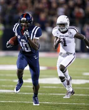 Mississippi wide receiver Vince Sanders (10) runs for a 70-yard touchdown pass reception past Texas A&M defensive back De'Vante Harris (1) in the first half of their NCAA college football game at Vaught-Hemingway Stadium in Oxford, Miss., Saturday, Oct. 12, 2013. (AP Photo/Rogelio V. Solis) Photo: Rogelio V. Solis, Associated Press