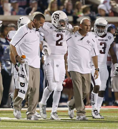 Texas A&M quarterback Johnny Manziel (2) is helped off the field with an injury in the first half of