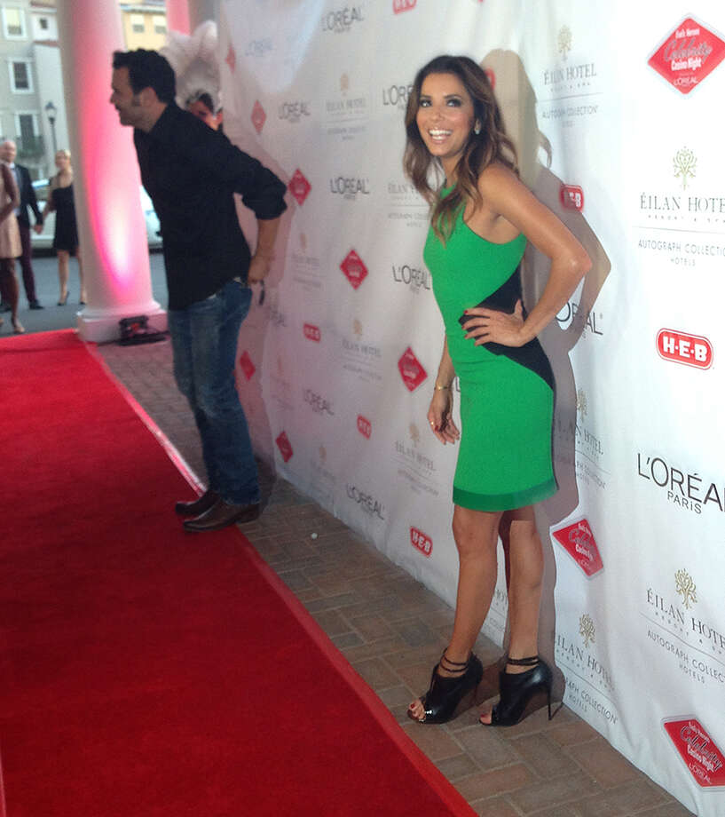 Eva Longoria walks the red carpet at her Eva's Heroes Celebrity Casino Night at Eilan Hotel Resort and Spa on Saturday, Oct. 12, 2013. Photo: Sarah Tressler/Express-News