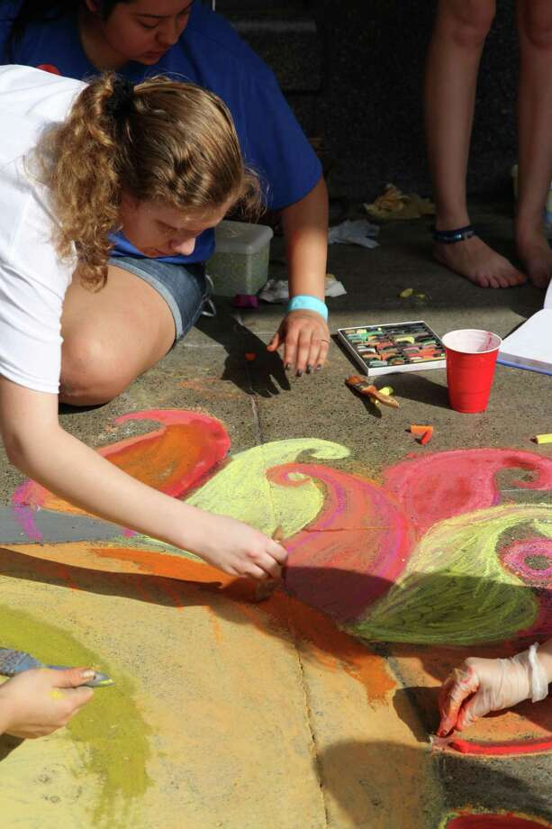 Houston Street was the colorful scene for artists of all ages at Chalk It Up 2013. Photo: Xelina Flores-Chasnoff/For MySA.com