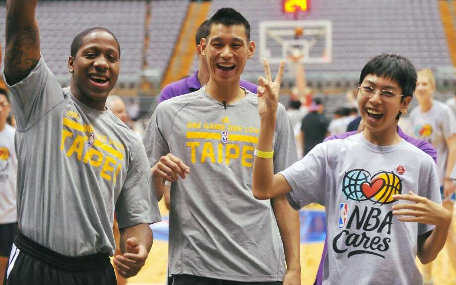 Isaiah Canaan and Jeremy Lin take part in a basketball clinic for students during the NBA Cares Special Olympics Clinic on Saturday in Taipei. Photo: Mandy Cheng, AFP/Getty Images