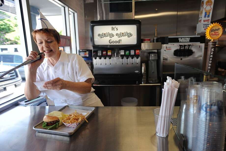 Sharon Thibodeaux calls out an order to be picked up at Willy Burger. Guiseppe Barranco/The Enterprise Photo: Guiseppe Barranco/The Enterprise