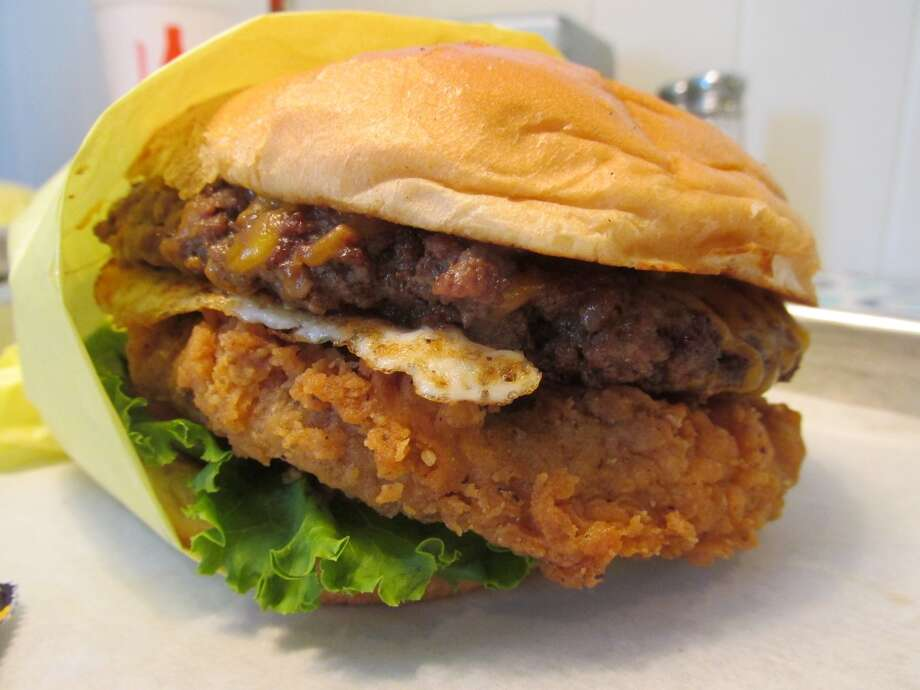 The Booty Burger at Willy Burger in Beaumont is made with fried boudain, beef, Creole mustard, lettuce and tomato. Photo: Cat5