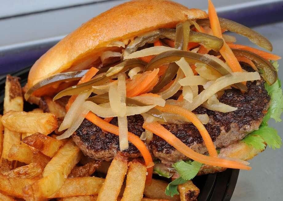 The Saigon Burger at Burger Guys consists of cilantro, cucumber, sriracha aidi date, daikon carrot and jalapeno.  Photo taken Thursday, June 20, 2013 Guiseppe Barranco/The Enterprise Photo: Guiseppe Barranco/The Enterprise
