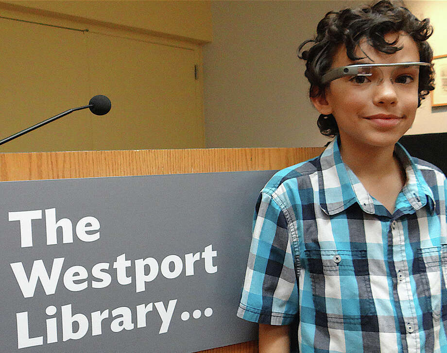 Kevin Nobrega, 11, of Southbury got to try out a Google Glass prototype that was demonstrated Saturday at the Westport Library. WESTPORT NEWS, CT 10/12/13 Photo: Mike Lauterborn / Westport News contributed