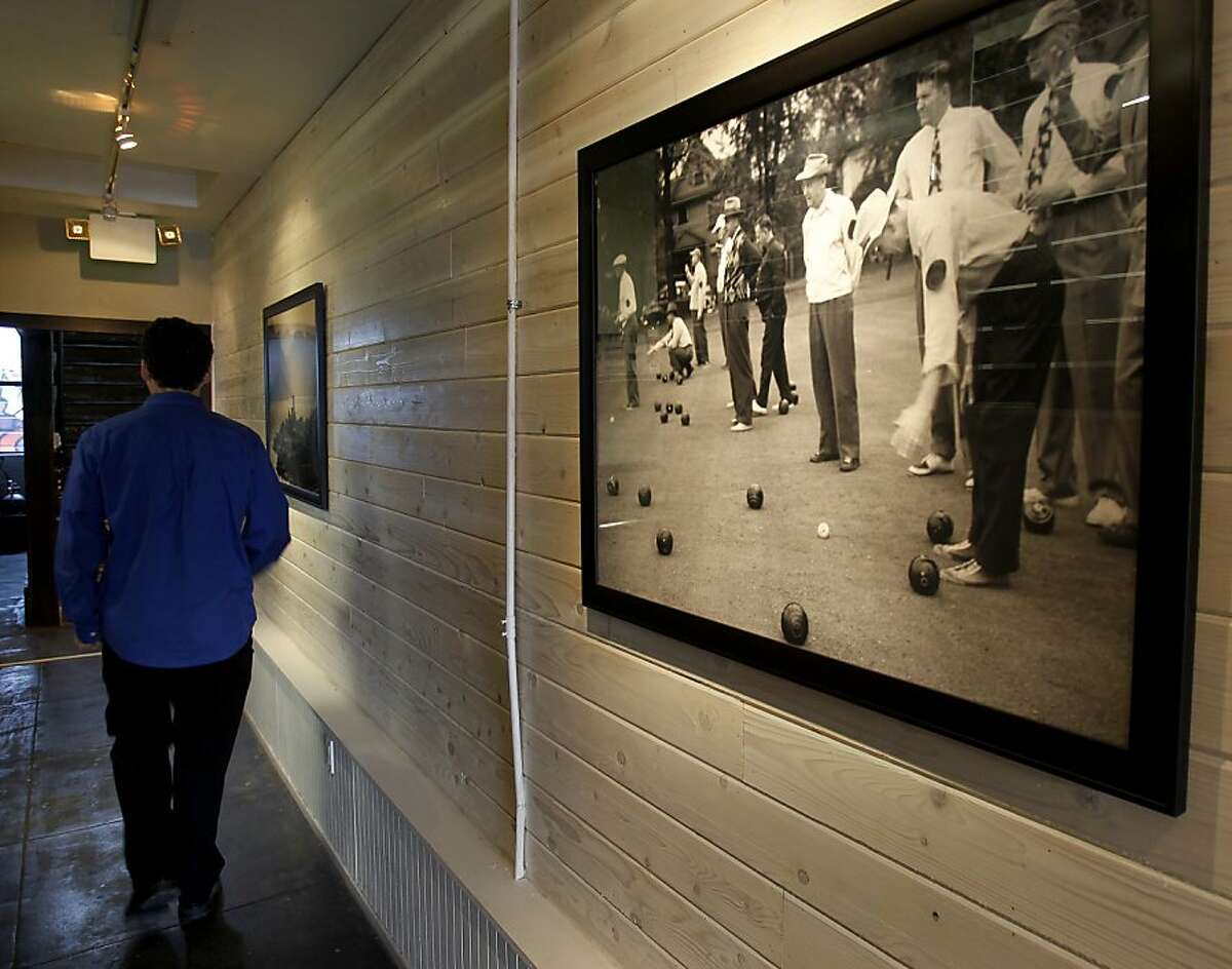 A large picture in the hallway between the outdoor area and the front has a picture of bocce ball playing Thursday October 10, 2013 in San Francisco, Calif. Rustica restaurant near 24th and Mission is trying to get approval for putting bocce ball courts in an area behind the restaurant.