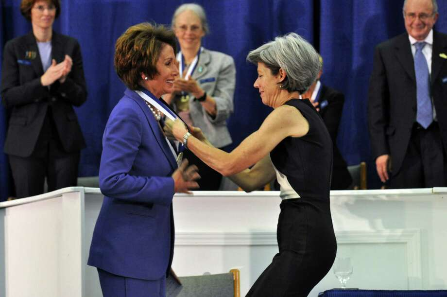Nancy Pelosi accepts her medal from Beth Quillen Thomas, co-president of the National Women's Hall of Fame board of directors, during the induction ceremony for the National Women's Hall of Fame Saturday Oct. 12, 2013 at the New York Chiropractic College Athletic Center in Seneca Falls, N.Y. Photo: Susan Clark Porter, AP / Finger Lakes Times