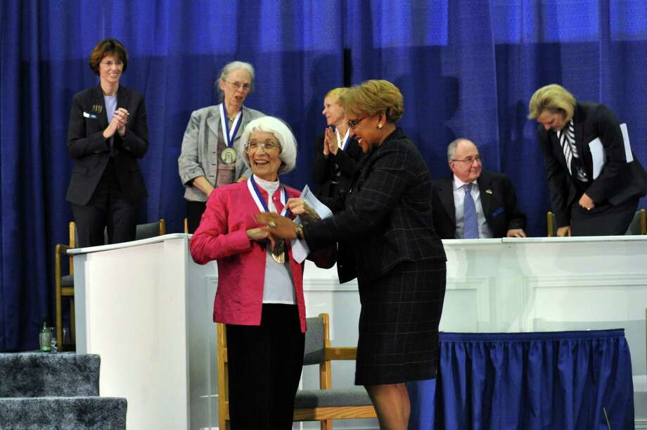 Bernice Resnick Sandler, who was instrumental in the development, passage and implementation of Title IX, the legislation that prohibits discrimination on the basis of sex in any federally funded education program or activity, accepts her induction medal from Beverly Ryder, co-president of the National Women's Hall of Fame during the induction ceremony for the National Women's Hall of Fame Saturday Oct. 12, 2013 at the New York Chiropractic College Athletic Center in Seneca Falls, N.Y. Photo: Susan Clark Porter, AP / Finger Lakes Times