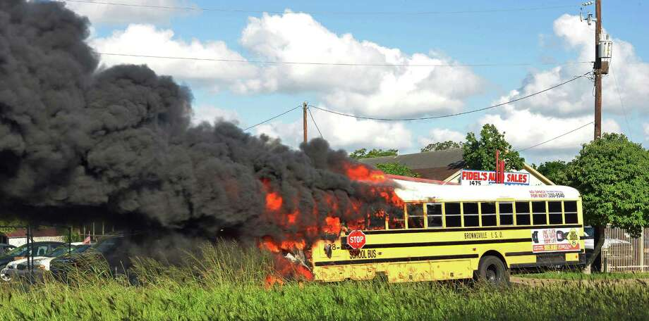 A school bus is consumed by fire Friday, Oct. 11, 2013 in Brownsville, Texas. Dozens of school buses operated by a South Texas district face inspections after engine compartment-related fires destroyed one bus and left another damaged. Photo: Miguel Roberts, AP / The Brownsville Herald