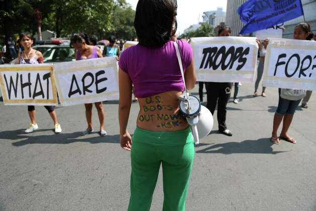 Military Slogans Filipino women hold slogans@Share on ...