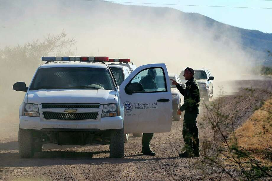 In this Oct. 2, 1012 file photo, several U.S. Customs and Border Protection officers and other law enforcement jurisdictions drive the roads near where a U.S. Border Patrol agent was shot and killed, and one other was shot and injured, where the shooting took place, near Bisbee, Ariz. Border Patrol agents in southern Arizona are subjecting U.S. citizens to illegal searches, detentions and excessive force in many cases miles from the state's border with Mexico, the American Civil Liberties Union wrote in a complaint Wednesday, Oct. 9, 2013. Photo: Ross D. Franklin, AP / AP