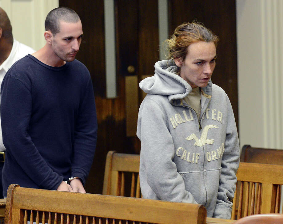 Ryan J. Barry, left, and Ashley Cyr, right, are led into Brockton, Mass., Superior Court for arraignment Friday, Oct. 11, 2013, on charges of manslaughter in the death of their 5-month-old daughter Mya Berry, by giving her a bottle of formula with heroin in September 2011. The couple pleaded not guilty. Photo: Ted Fitzgerald, AP / Pool, Boston Herald
