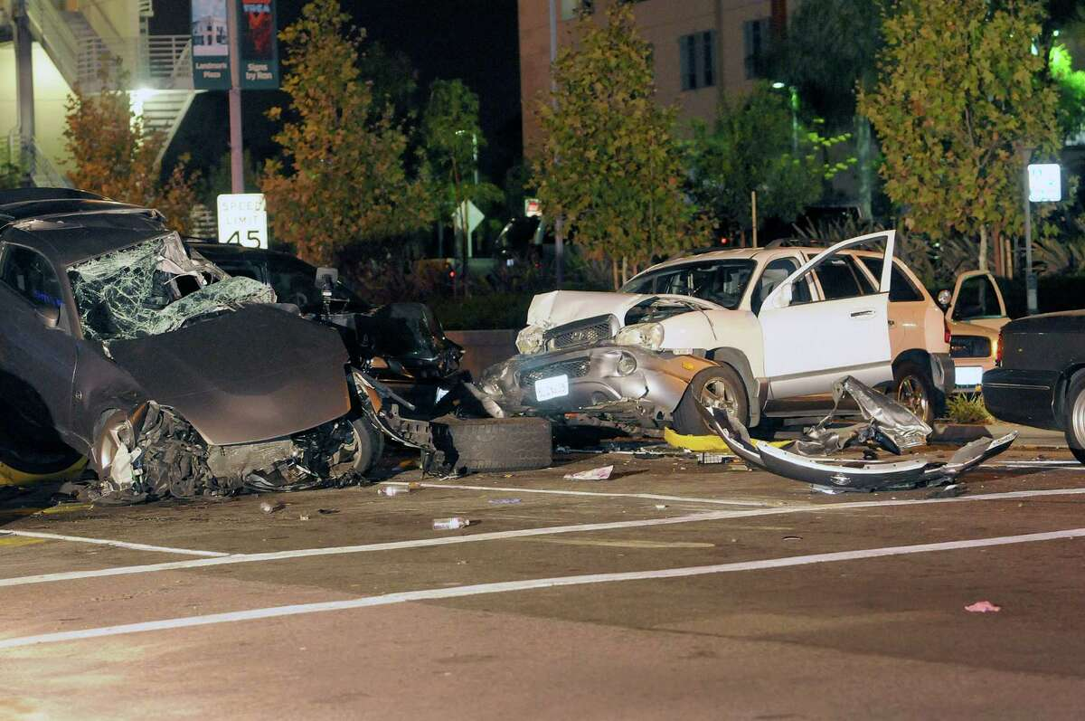 This image provided by Richard Koehler shows the site, Oct. 10, 2013, of a eight vehicle accident in Fullerton, Calif., that left one person dead and injured several others. The crash about 30 miles southeast of Los Angeles happened late Thursday afternoon when the driver of a pickup truck crossed a double yellow line and swerved into oncoming lanes to pass cars stopped at an intersection, said Fullerton police Sgt. Jeff Stuart.
