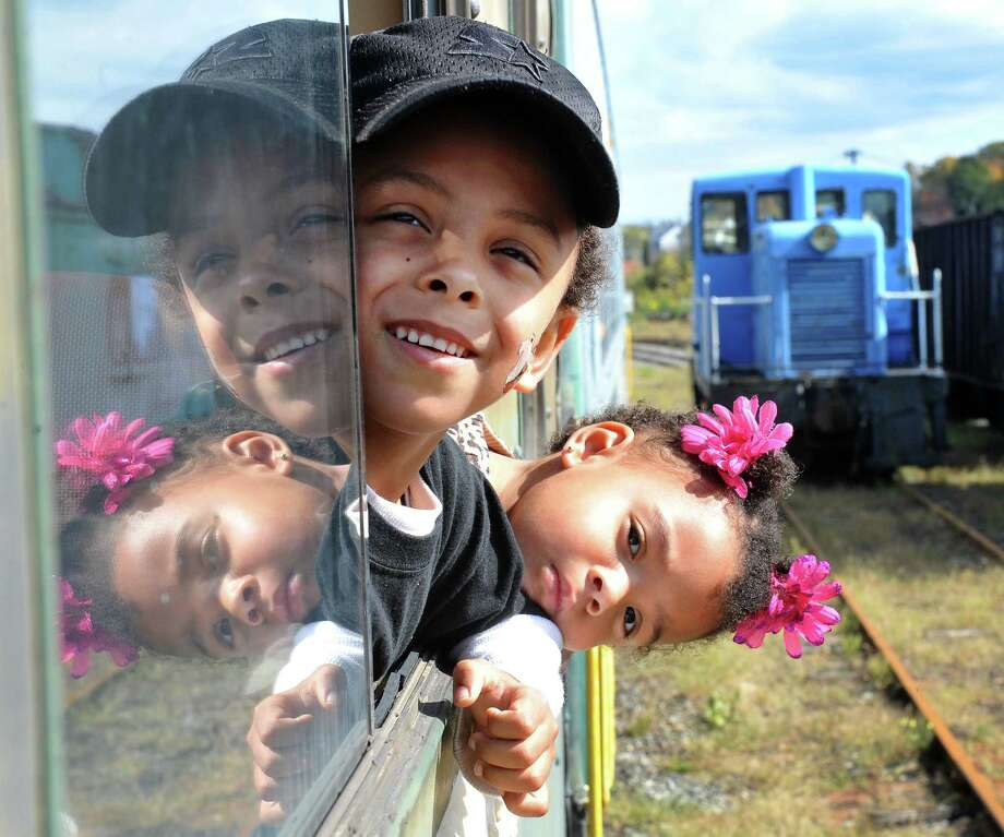 Ryder Laurel, 4, and his sister, Dakota, 2, take in the view during the Danbury Railway Museum Pumpkin Patch train ride, in Danbury, Conn. Sunday, Oct. 13, 2013. Photo: Michael Duffy / The News-Times