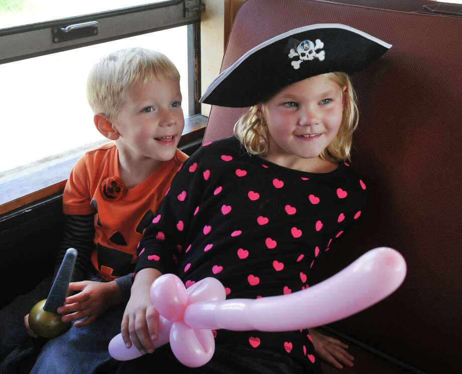 Aiden Jennings, 4, and his sister, Sarah, 7, are in costume during the Danbury Railway Museum Pumpkin Patch train ride in Danbury, Conn. Sunday, Oct. 13, 2013. Photo: Michael Duffy / The News-Times